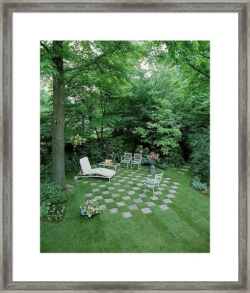 A Garden With Checkered Pavement Framed Print