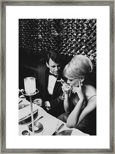 A Glamorous 1960s Couple Dining Framed Print by Horn & Griner