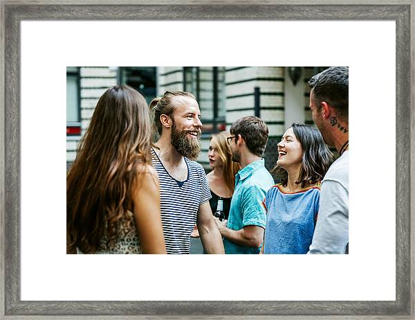 A Group Of Friends Meeting Together At Barbecue Framed Print by Hinterhaus Productions