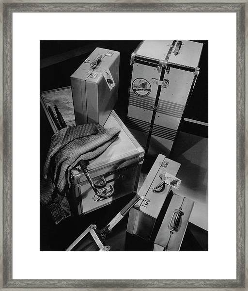 A Group Of Suitcases Ready For Travel Framed Print