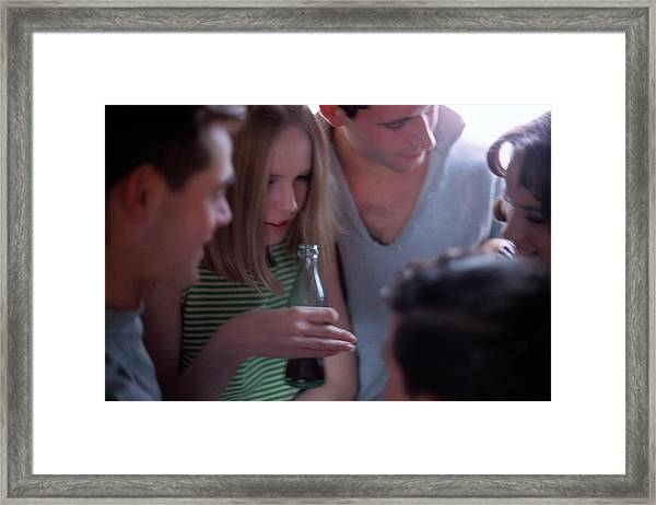 A Group Of Young People Framed Print