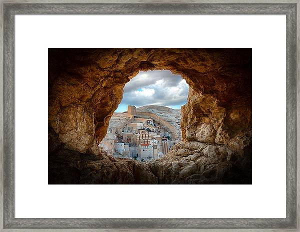 A Hole In The Wall Framed Print