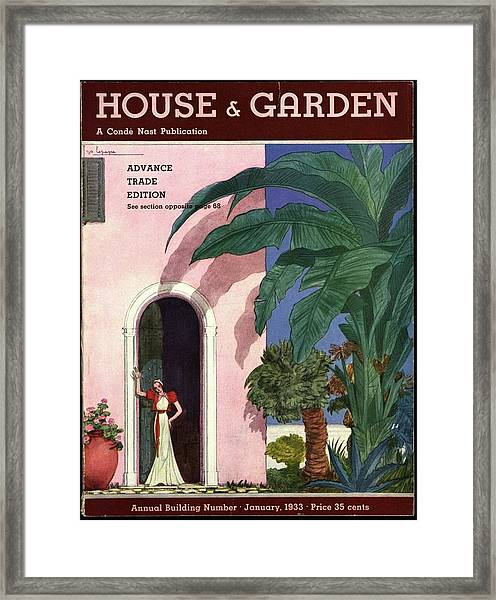 A House And Garden Cover Of A Woman In A Doorway Framed Print