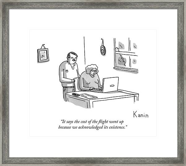 A Husband And Wife Look At Their Laptop Framed Print
