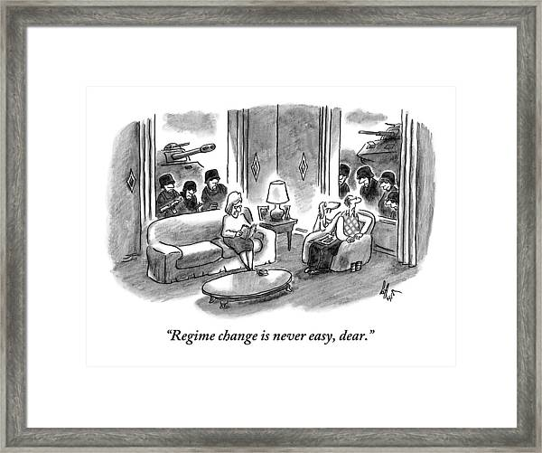A Husband And Wife Sit In Their Living Room Framed Print