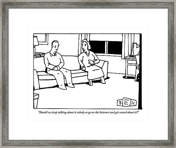 A Husband And Wife Sit On The Sofa Framed Print