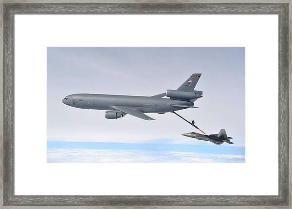 A Kc-10 Extender Refuels An F-22 Raptor Framed Print
