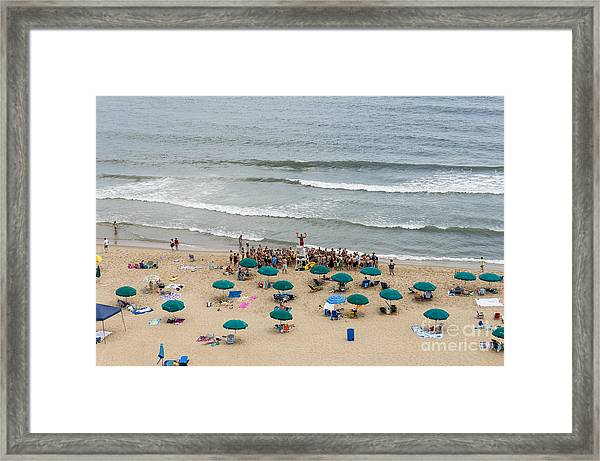 A Lifeguard Gives A Safety Briefing To Beachgoers In Ocean City Maryland Framed Print