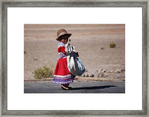 A Little Girl In The  High Plain Framed Print