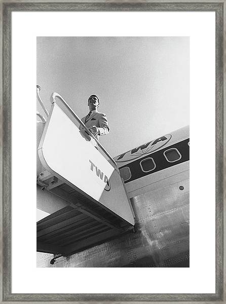 A Male Model Disembarking A Twa Boeing 707 Plane Framed Print
