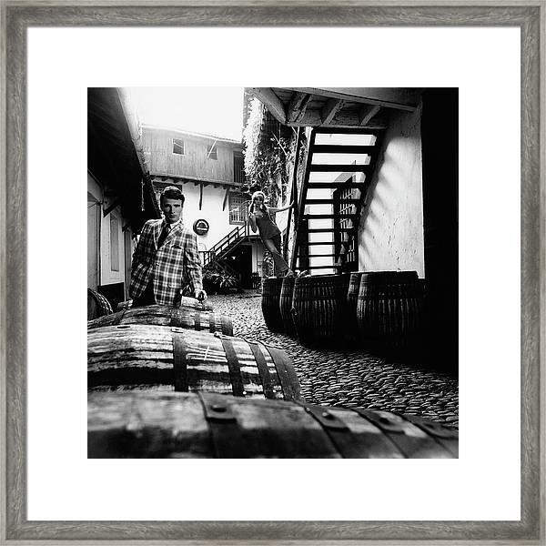 A Male Model Posing By Wine Barrels Framed Print