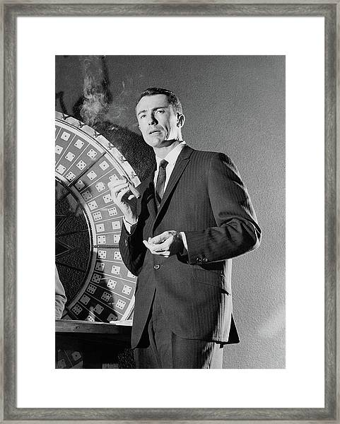 A Male Model Wearing A Dark Pinstriped Suit Framed Print by Richard Waite