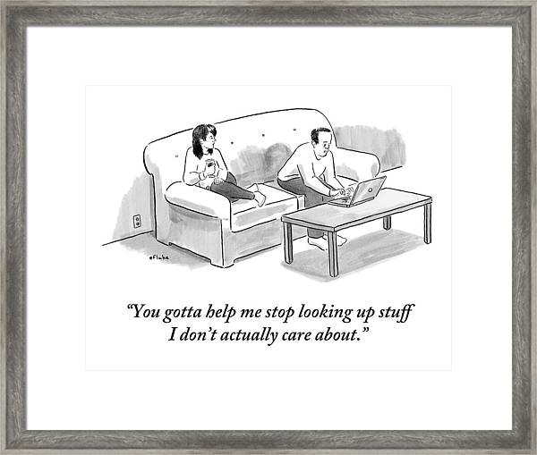 A Man And A Woman Sit On A Couch.  The Man Framed Print