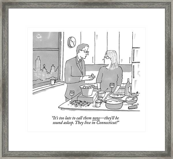 A Man And Wife Stand In The Kitchen Framed Print