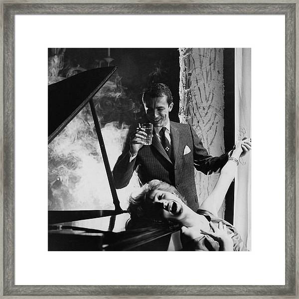 A Man And Woman By A Piano Framed Print