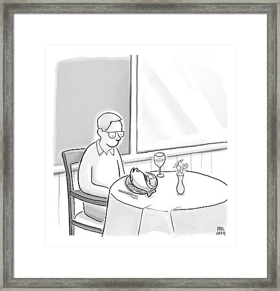A Man At A Restaurants Looks At The Fish Framed Print
