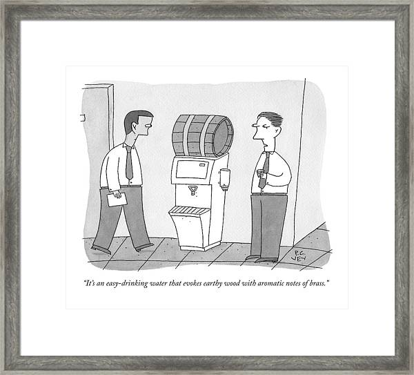 A Man By A Water Cooler That Has Been Replaced Framed Print