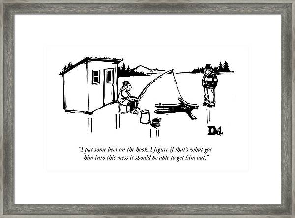 A Man Ice Fishes Through Man-shaped Hole Framed Print