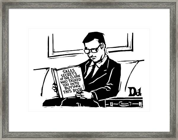 A Man In A Suit Reads A Book With The Title: Framed Print