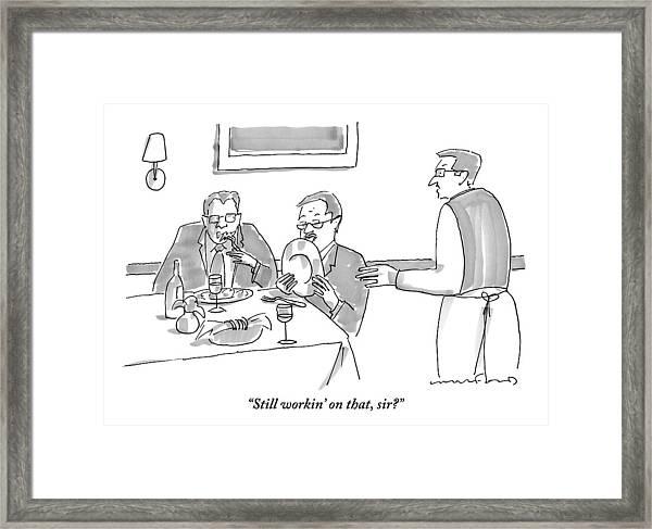 A Man Licks His Plate Clean At A Restaurant Framed Print
