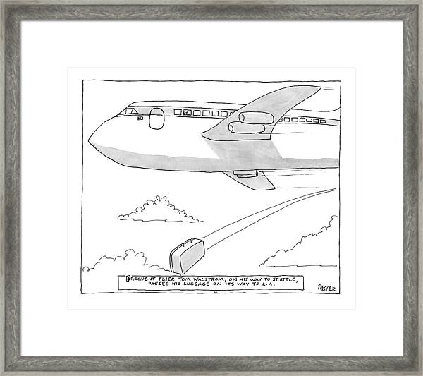 A Man Looks Out The Window Of An Airplane Framed Print