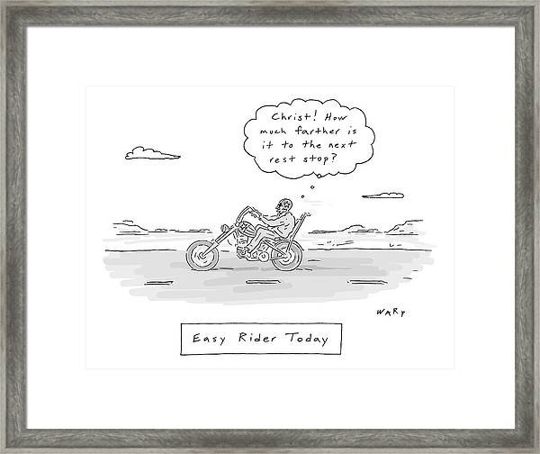 A Man On A Low Rider Motorcycle Makes His Way Framed Print