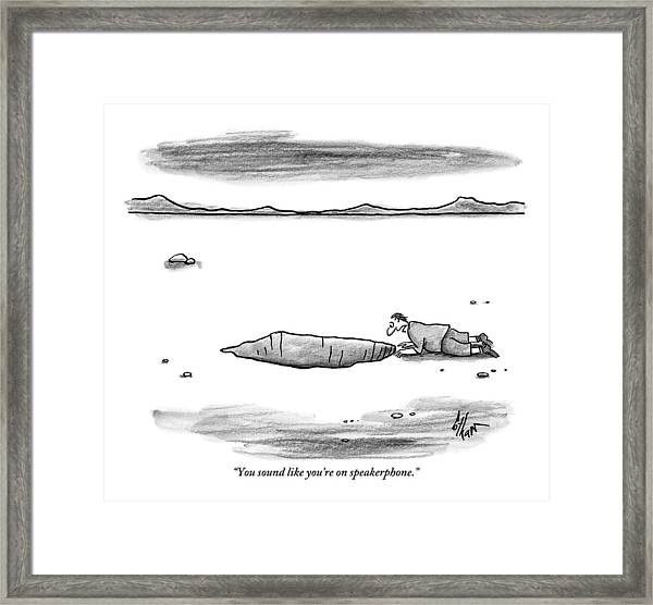 A Man Shouts Down Into A Large Hole In The Ground Framed Print