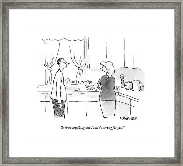 A Man Speaks To A Woman In A Kitchen Framed Print