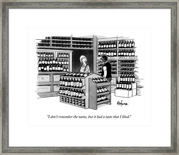 A Man Talking To An Employe At A Wine Store Framed Print