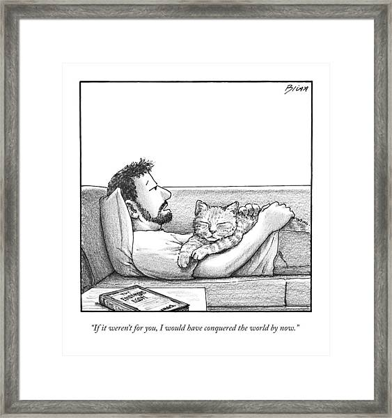 A Man Talking To The Cat Lying On His Stomach Framed Print