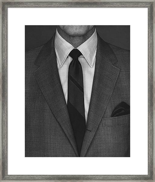 A Man Wearing A Suit Framed Print by Peter Scolamiero