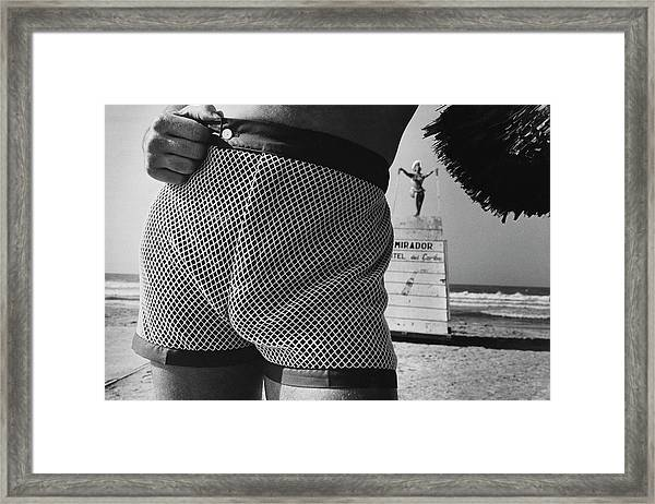 A Man Wearing A Swimsuit Framed Print