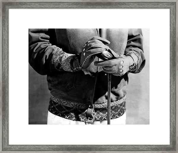A Man Wearing Gloves Framed Print