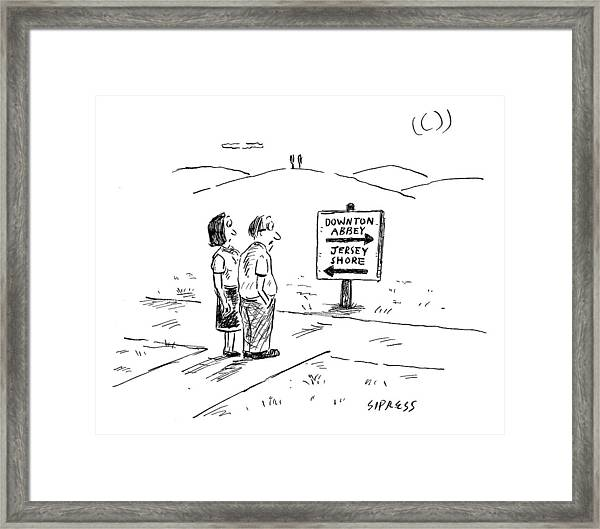 A Middle-aged Couple Stand At A Road Sign Framed Print