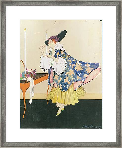 A Model Applying Lipstick Framed Print by E.M.A. Steinmetz