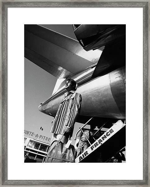 A Model By An Air France Airplane Framed Print