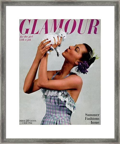 A Model Holding A Kitten Framed Print