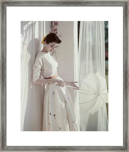 A Model Holding A Parasol Framed Print