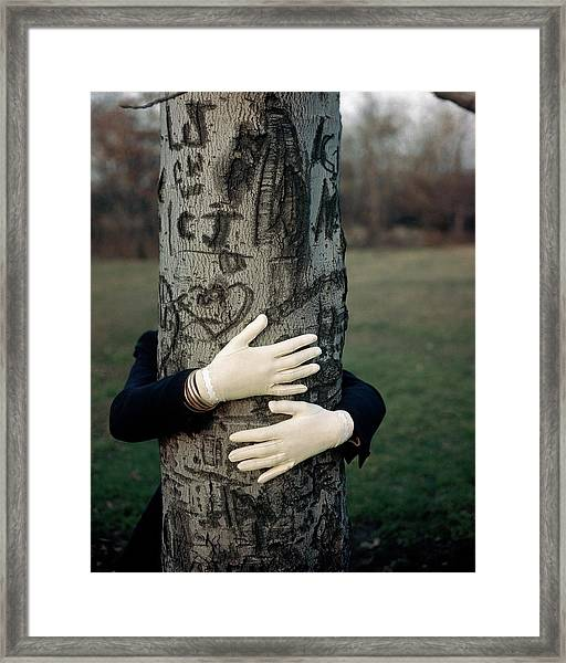A Model Hugging A Tree Framed Print