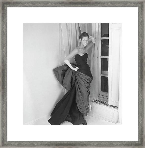 A Model In A Schiaparelli Dress Framed Print by Henry Clarke