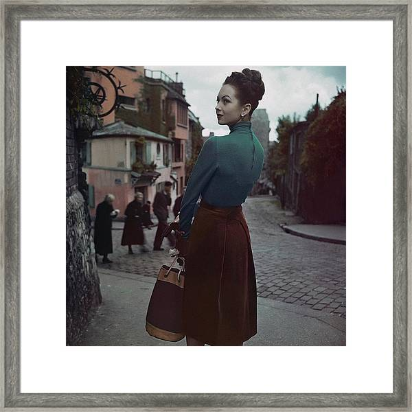 A Model In Paris Framed Print by John Rawlings