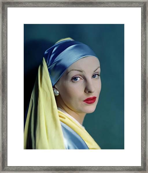 A Model In The Style Of Johannes Vermeer's Girl Framed Print