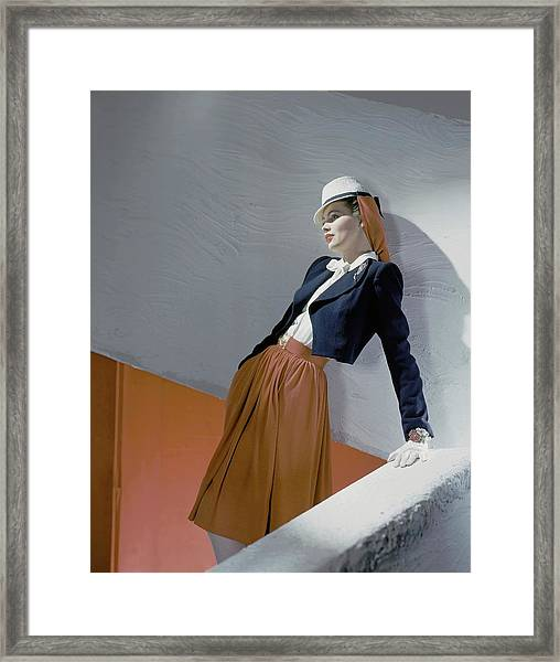 A Model Leaning On A Wall Framed Print by Horst P. Horst