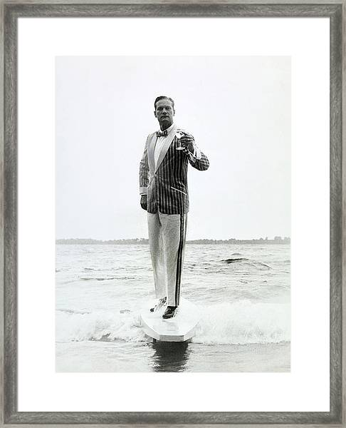 A Model Stands In The Surf In Bronzini Framed Print