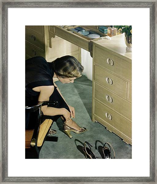 A Model Trying On A Pair Of High Heels Framed Print