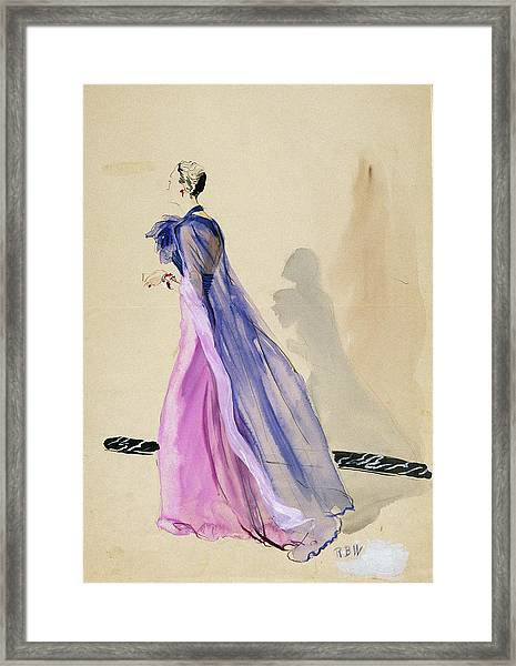 A Model Wearing A Blue Cape And Pink Chiffon Framed Print