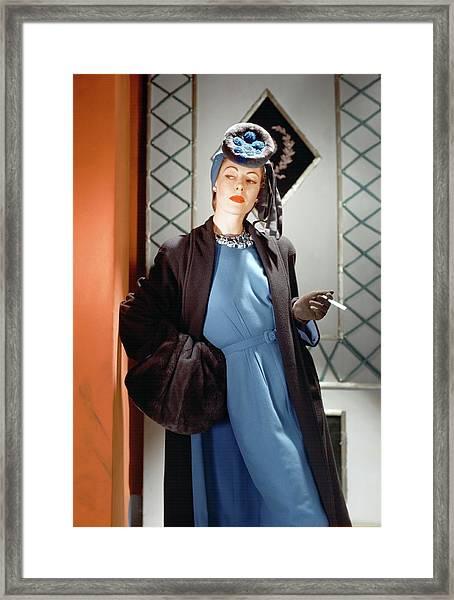 A Model Wearing A Blue Dress Framed Print