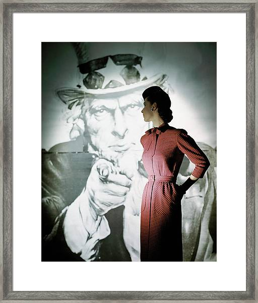 A Model Wearing A Checked Dress Framed Print by John Rawlings