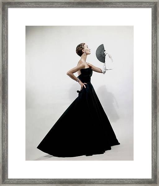 A Model Wearing A Christian Dior Dress Framed Print
