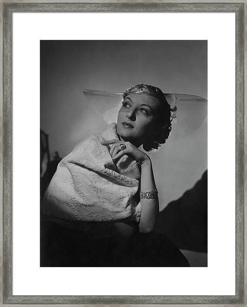 A Model Wearing A Coat And Glass Hat Framed Print